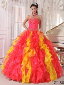 Coral Red and Orange Sequined Sweetheart Dress for Quinces with Ruffles