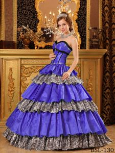 Exclusive Animal Print Multi-color Quinceanera Gown with Ruffled Layers