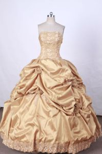 Gold Strapless Appliques and Pick-ups Quinceanera Dress in Santos Brazil