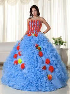 Blue Ruffled Strapless Sweet 15 Dress in Floor-length with Hand Made Flower