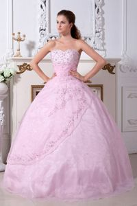 Light Pink Beaded Sweetheart Floor-length Quince Dresses with Embroidery